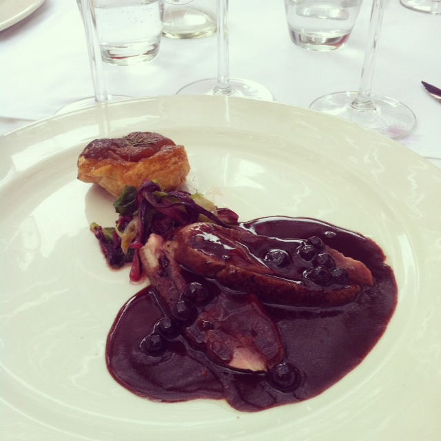 Grilled duck, rosemary and turnip Tarte Tartin, bitter leaves and blackcurrant jus.