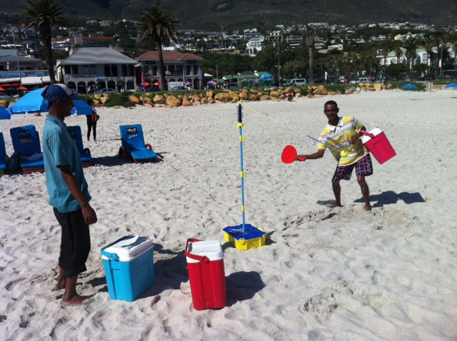 Yesterday on Camps Bay beach two guys selling cold drinks decided to have a go on our swing ball set. I wish I could have recorded their giggling and the things they were saying to one another (Djy speel kak! Slaan hom! Slaan hon!). One of those lost-in-translation moments.