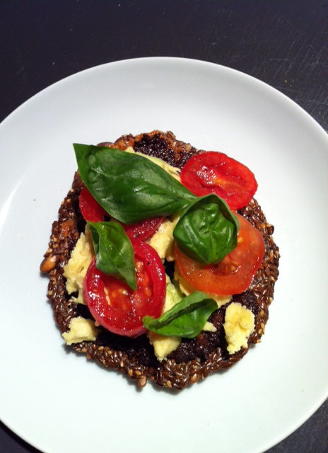 Raw 'pizza' with smoked olive paste, avo, fresh tomatoes and basil