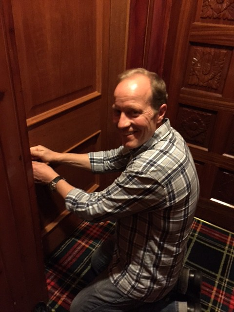 Unlocking the door to our hotel room.
